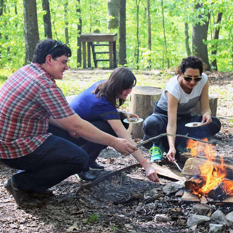 Retreat participants build a campfire
