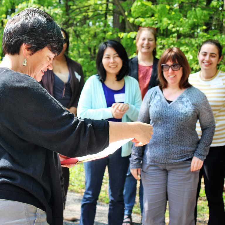 Retreat participants are led in an outdoor exercise